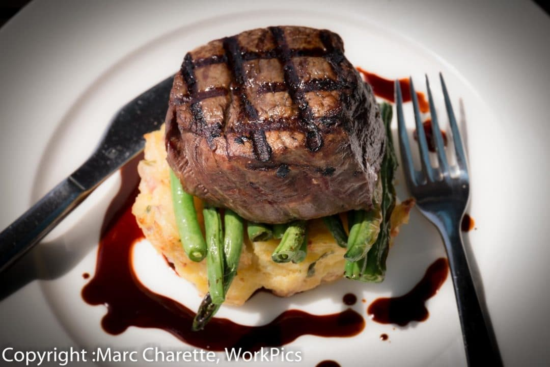Commercial photography for restaurant of plated steak meak
