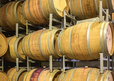 Commercial photography of winery with barrels of wine
