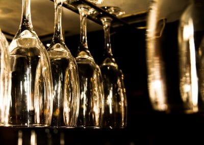 Commercial photography or winery bar with glasses hanging for serving